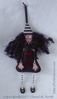 Photo showing mixed media art doll.