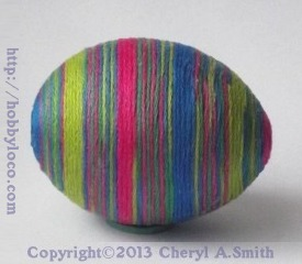 thread wrapped egg